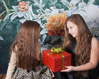 Sister sharing gift stock photo