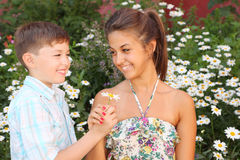 Sister take flower from brother Stock Image