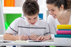 Sister teaching brother Royalty Free Stock Photo