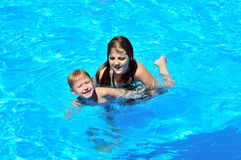 Sister teaching brother to swim Stock Image