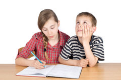Sister Teaching Maths to Her Younger Disinterested Brother Isolated on White Stock Photography