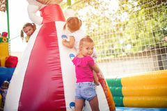 Sister is always there as support and help. Three little girl playing together on playground royalty free stock images