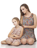 Sister weaving braids with her little girl Royalty Free Stock Photography