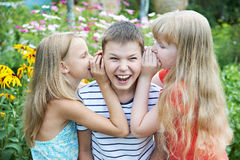 Sister whispered to his brother royalty free stock photo