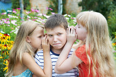 Sister whispered to his brother Stock Images