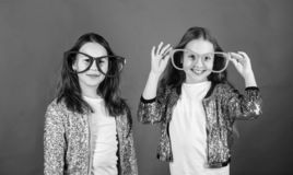 Sisterhood concept. Friendly relations siblings. Sincere cheerful kids share happiness and love. Girls funny big stock image