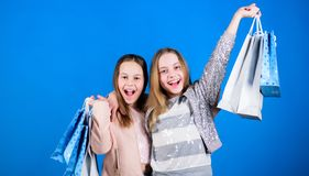 Sisterhood and family. savings on purchases. Sales and discounts. Kid fashion. Small girls with shopping bags. Happy. Children. Little girl sisters enjoying stock photos