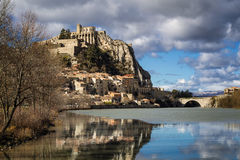 Sisteron Citadel, fortifications , Durance River with clouds. Southern Alps, France Stock Photo