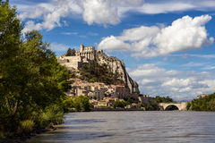 Sisteron Citadel, fortifications , Durance River with clouds. Southern Alps, France Royalty Free Stock Photo