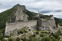 Sisteron fortress. Powerful Sisteron ancient fort on the background of mountains Royalty Free Stock Photography