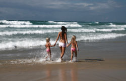 Sisters. Wading in ocean Royalty Free Stock Image