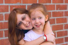 Sisters. Two sisters hugging and happy together Stock Photography