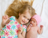 Sisters. Sister Laying with New Baby Sister Stock Photography
