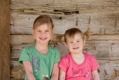 Sisters. Two Sisters Smiling Big in Front of Home Stock Images