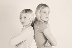 Sisters. Two sisters that are mad at each other Stock Image