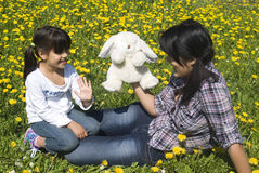 Sisters. Two sisters playing in the meadow of spring Stock Photo