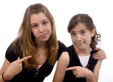 Sisters. Two sisters joking around. family, friends, growing up Royalty Free Stock Photography