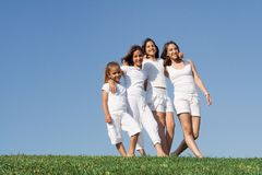 Sisters. Happy smiling group of kids or children at summer camp Royalty Free Stock Images