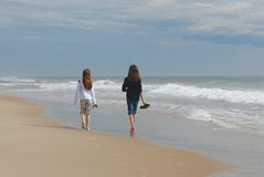 Sisters. Taking a walk on the beach on a brisk April morning Stock Images