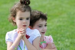 Sisters. An outdoor portrait of two 4 year old girls Royalty Free Stock Photo