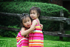 Sisters. Hugging each other on a summer day Stock Photo