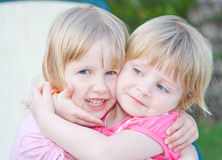 Sisters. Beautiful little girls in nature Royalty Free Stock Photos