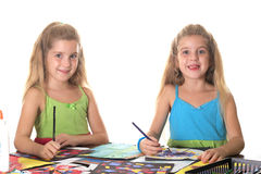 Sisters arts & craft smile. Sisters arts & craft smile isolated on a white background Royalty Free Stock Image