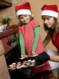 Sisters baking christmas cookies Royalty Free Stock Image