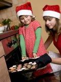 Sisters baking christmas cookies Royalty Free Stock Image
