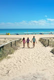Sisters at the beach. Three girls running down to the beach Royalty Free Stock Image