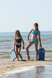 Sisters at the beach. Two blonde girls having fun at the beach Stock Images