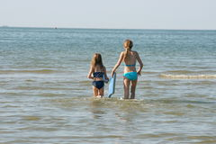Sisters at the beach. Two blonde girls having fun at the beach Stock Image