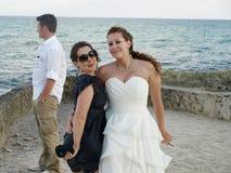 Sisters at beach wedding stock image