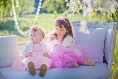 Sisters in blossom park Royalty Free Stock Photo