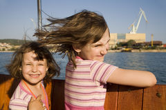 Sisters on the boot in holiday Royalty Free Stock Photography
