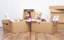 Sisters in box Stock Photos