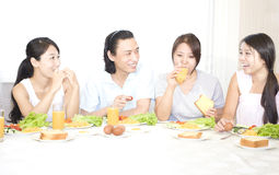 Sisters and brother having breakfirst stock images