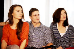 Sisters and brother relaxing at home. Stock Photography