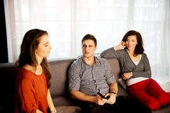 Sisters and brother relaxing at home. Stock Images