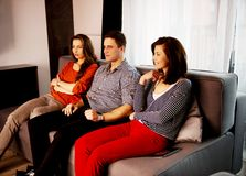 Sisters and brother relaxing at home. Royalty Free Stock Photography
