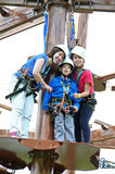 Sisters and brother on the roap course sky trail Royalty Free Stock Photos