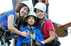 Sisters and brother on the roap course sky trail Stock Image