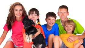 Sisters, brothers and dog pet  Stock Image
