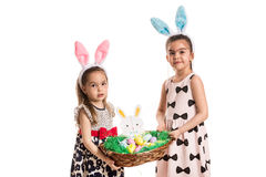 Sisters with bunny ears holding basket Stock Images