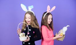 Sisters celebrate easter. Spring holiday. Happy childhood. Easter day. Easter activities for children. Happy easter. Holiday bunny girls with long bunny ears royalty free stock images