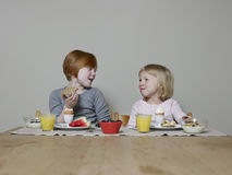 Sisters Chat While Eating Breakfast Royalty Free Stock Photos