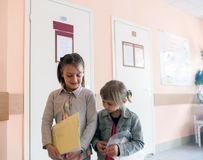 Girls in  children`s polyclinic. Sisters in children`s hospital  waiting for   doctor royalty free stock photos