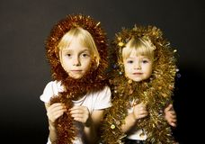 Sisters- Christmas greetings. Portrait of cute sisters during Christmas Royalty Free Stock Image