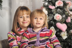 Sisters on Christmas time Stock Photos