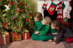 Sisters at the christmas tree royalty free stock photo